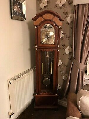 Grandfather clock.walnut effect. Battery operated. Very good condition