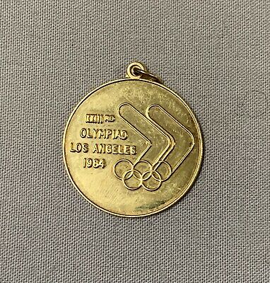 "9Ct Gold 2Cm ""Xxii Rd Olympiad Los Angeles 1984 "" Pendant"