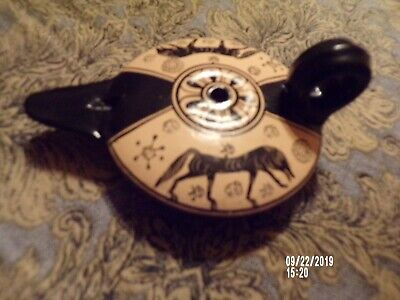 Old type pottery oil lamp from Greece handmade and handpainted.