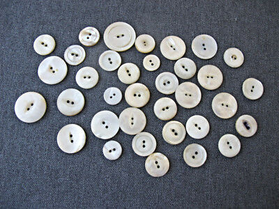 34 Antique different sizes & shapes mother of pearl mop buttons lot