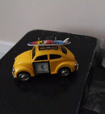 vw display car, with inbuilt clock and key, yellow in colour
