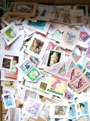 used stamps collection 100 on paper world. ( kiloware ). No gb