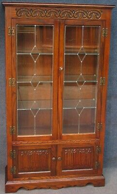 Old Charm Carved Oak Display Cabinet With Leaded Glass And Linen Fold Doors