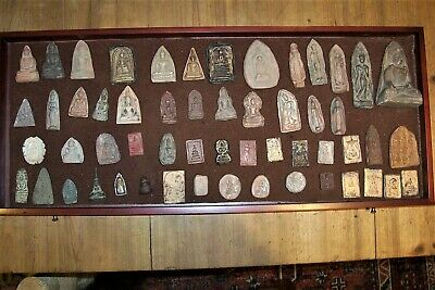 A Collection of 55 Eighteenth / Nineteenth century Antique Buddhist Amulets.