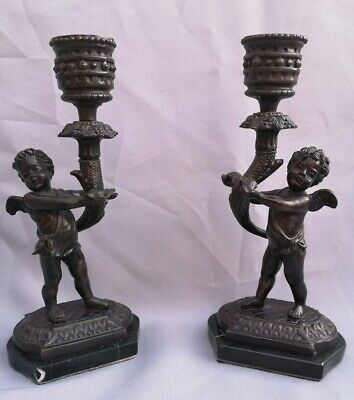 Antique Bronze French Cherub putti design candlesticks on veined marble bases