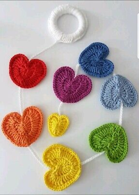 Handmade crochet baby mobile or room decoration in bright rainbow colours