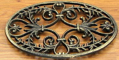 "Cast Iron Ornate Oval  Trivet Rustic Brown And Gold   9""  Wide"