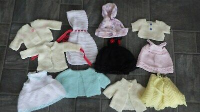 bundle of hand knitted dolls clothes -small size