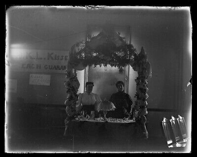 "LATE 1800s EARLY 1900s GLASS NEGATIVE, ""KISSES"" BOOTH, UNKNOWN LOCATION"