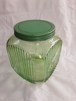 Green depression glass cookie jar very good condition, one small crack on rim