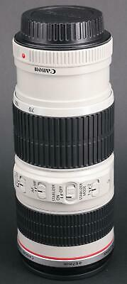 Near mint Canon EF 70-200mm F/4L IS USM zoom lens in original box and packaging