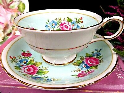 Paragon tea cup and saucer baby blue and super flowers teacup England 1940s
