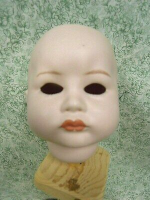 "cp-1336  porcelain repro doll head -""SFBJ  252  PARIS  11 = imprint back of neck"