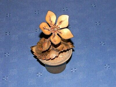 Bovano metal flower in small planter identification label attached