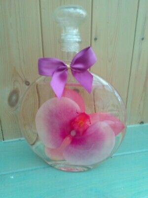 NEW LARGE GLASS BOTTLE of FOAM BATH OIL with DECORATIVE ORCHID INSIDE