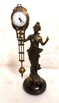 Unusual Diana Mystery Swinger Clock- Clock Swings Back & Forth On The Statue