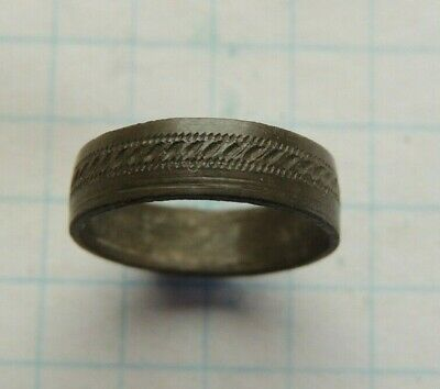 Ancient bronze wedding ring with drawings