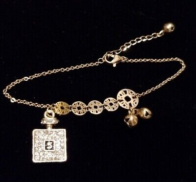Rose Gold Roman Numeral Bracelet With Crystal Perfume Bottle Charm