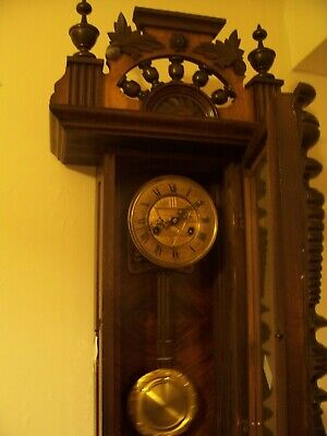 A very old wall clock spring driven