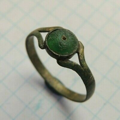 Ancient bronze ring with stones