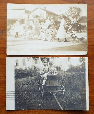 2 Old Antique REAL PHOTO POSTCARDS Children Wooden Wagon DOLL PARADE