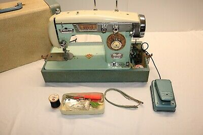 Housekeeper Deluxe vintage Japan Heavy Duty Zig Zag Sewing Machine with extras