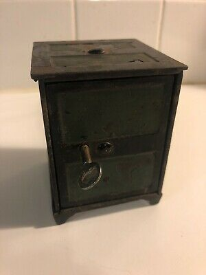 Early 1900s antique Cast Iron metal Still coin bank With Key Original Paint