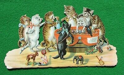 Large Victorian die-cut scrap Cats finding toys at the Lucky Dip 100 x 185 mm