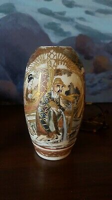 Antique Japanese or Chinese ceramic vase, has gold overlay highlight detail