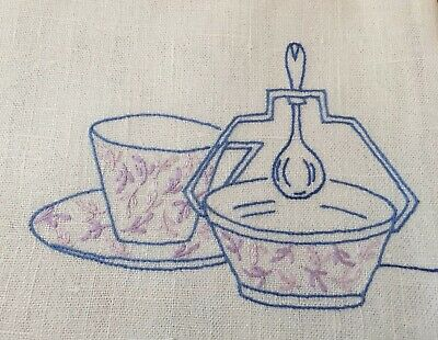 Lovely vintage linen tea towel with embroidered tea cup and sugar bowl