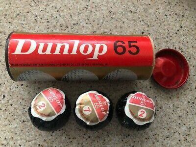 3 Vintage Wrapped Golf Balls in their original metal container - mint unused