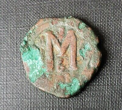 #f439# Byzantine Follis coin of Justin II from 565-578 AD