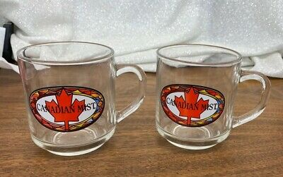 "2 ""Canadian Mist"" Clear Advertising Mugs with Handles"