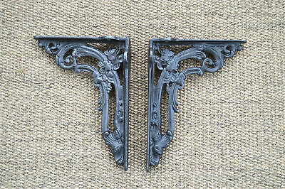 A pair of cast iron Victorian style foliage shelf brackets shelving cistern