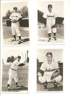 Lot of 4 signed 1950s Cleveland Indians team issued postcards, pinholes