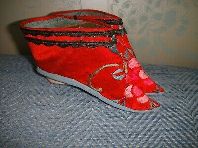 Pair of vintage embroidered red binding shoes