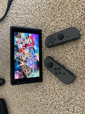 Nintendo Switch 32GB Console with Gray Joy‑Con And PS4 Controller