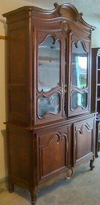 Circa 1870 French Oak Cupboard with Hand Blown Glass Doors