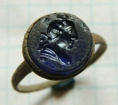 Ancient bronze ring  Middle Ages with a human face