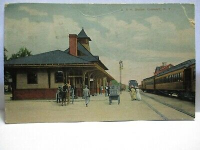 """1909 Postcard """" D. & H. Station, Cobleskill Ny """" People At Station, Trains, Cart"""