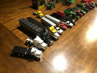 ERTL model tractors they are John Deere case international with implements