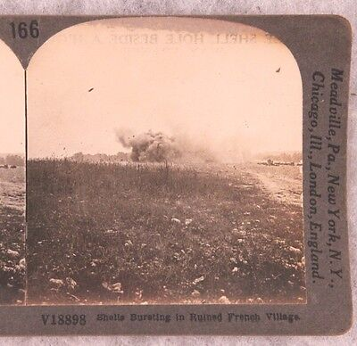 Stereoview card: Artillery Shell Explores in French Village