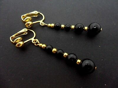 A PAIR OF DANGLY BLACK ONYX BEAD  GOLD PLATED CLIP ON   EARRINGS.