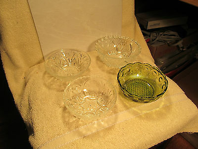 Set of 4 different vintage pressed glass berry bowls.