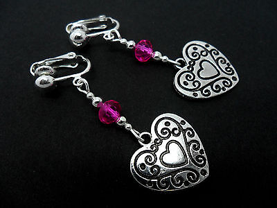 A PAIR OF DANGLY TIBETAN SILVER  BLACK BEAD  HEART    EARRINGS.  NEW.