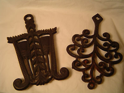 Nice pair of vintage cast iron kitchen trivets.