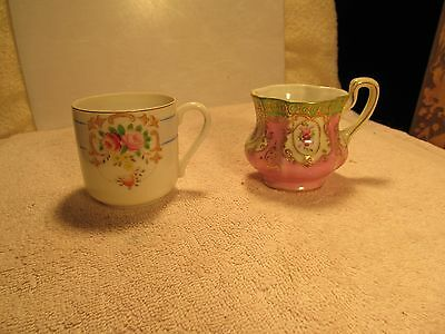 2 small porcelain Occupied Japan marked decorative collector cups.