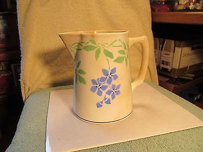 """Vintage 6"""" tall green & blued colored floral designed pottery pitcher."""