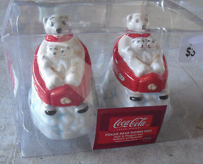 Coca Cola Polar Bears in Sleds Salt and Pepper Shakers NIP