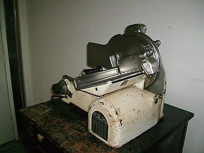 ANTIQUE MEAT SLICER VERY OLD AND VERY STRONG WILL CUT FROZEN MEAT WORKS FINE